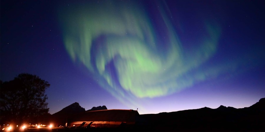 Northern-Lights-over-Lofotr-Vikingmuseum_Allen-Hwang.JPG